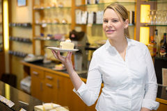 Waitress presenting cup of coffee or tea Royalty Free Stock Photography