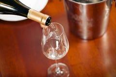Waitress refills glass Stock Photography
