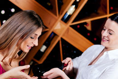 Waitress in restaurant offering red wine Royalty Free Stock Photo