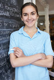 Waitress In Restaurant Writing Menu On Blackboard Royalty Free Stock Photos