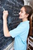 Waitress In Restaurant Writing Menu On Blackboard Stock Photos