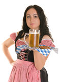 A waitress serves beer Royalty Free Stock Image