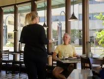 Waitress serves customer Royalty Free Stock Photo