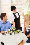 Waitress serving Stock Photo