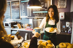 Free Waitress Serving A Cup Of Coffee Royalty Free Stock Image - 66975806