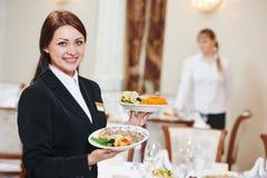 Waitress serving banquet table Stock Photo
