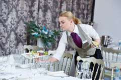 Waitress serving banquet table Royalty Free Stock Images