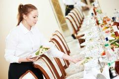 Waitress serving banquet table Stock Image