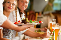 Waitress serving an Bavarian Restaurant Royalty Free Stock Photo