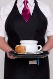 Waitress serving a bowl of soup Royalty Free Stock Photos