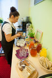 Waitress serving breakfast. In the hotel Royalty Free Stock Images