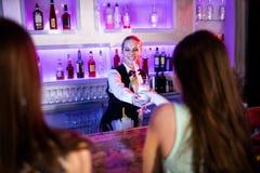 Waitress serving cocktail Stock Photos