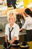 Waitress serving coffee cups making espresso woman Royalty Free Stock Images