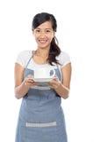 Waitress serving coffee Royalty Free Stock Photos