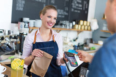 Waitress serving customer at the coffee shop Stock Photos