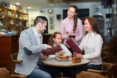 Waitress serving family of three Stock Photography