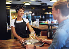 Waitress Serving Glasses of Wine to Customer Stock Photography