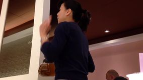 Waitress serving tea for customer stock video footage