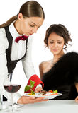 Waitress serving to beautiful female Royalty Free Stock Photography