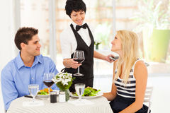 Waitress serving wine Royalty Free Stock Image