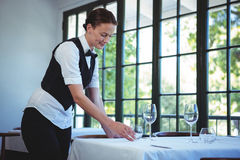 Waitress setting the table royalty free stock photography