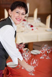 Waitress setting the table Stock Photos