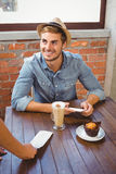 Waitress showing bill to handsome hipster Stock Photo