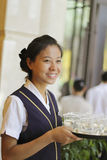Waitress smiling Stock Photography