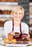 Waitress Stacking Muffins On Napkin Stock Photo