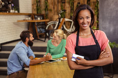 Waitress standing with arms crossed. In a cafe Royalty Free Stock Image