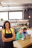 Waitress standing with arms crossed. In a cafe Royalty Free Stock Photos