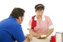 Waitress Takes Customer Order Stock Photo