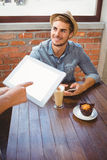 Waitress taking handsome hipsters order with tablet. At coffee shop Royalty Free Stock Photos