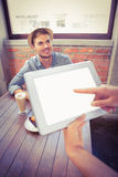 Waitress taking handsome hipsters order with tablet Royalty Free Stock Images