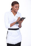 Waitress taking an order. Smiling young waitress taking an order Stock Photo