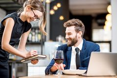 Waitress taking an order from businessman Stock Images