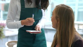 Waitress taking an order in cafe stock footage