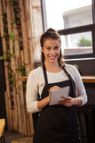 Waitress taking order in cafeteria Stock Photos
