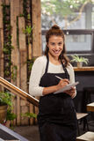A waitress is taking the order. In a coffee shop Stock Photography