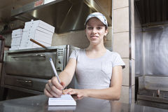 Waitress taking order in a fast food restaurant Royalty Free Stock Photography