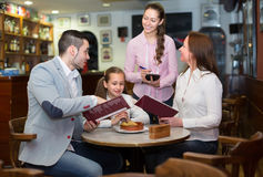 Waitress taking table order at cafe Stock Image