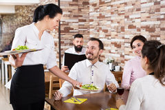 Waitress taking table order at tavern Stock Image