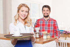 Waitress with tray on background of customer Royalty Free Stock Photo