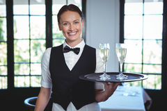 Waitress with a tray of flute of champagne Royalty Free Stock Images
