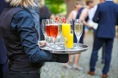 Waitress with a tray of glasses of different drinks at the wedd Stock Photos