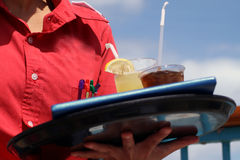 Waitress with two drinks Stock Image