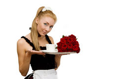 Waitress in uniform with tray and flowers Stock Images