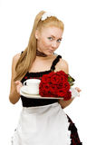 Waitress in uniform with tray and flowers Stock Photo