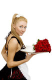 Waitress in uniform with tray and flowers Royalty Free Stock Images