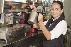 Waitress using coffee machines Royalty Free Stock Photos